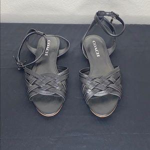 Black leather Coach flat sandals